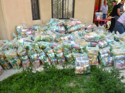 Distribution of relief, food packages for refugees that fled Mosul and villages of the Nineveh Plain.