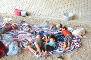 Children sleeping under highway fly-over