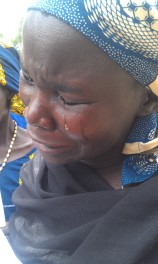 A mother cries over her missing daughter