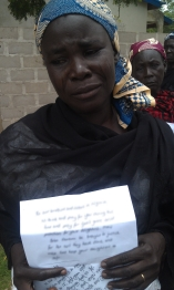 A Mother cries for her missing daughter, holding prayer messages from Open Doors supporters.