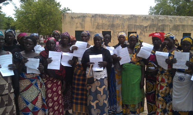 Mothers holding prayer messages in Chibok, Nigeria.