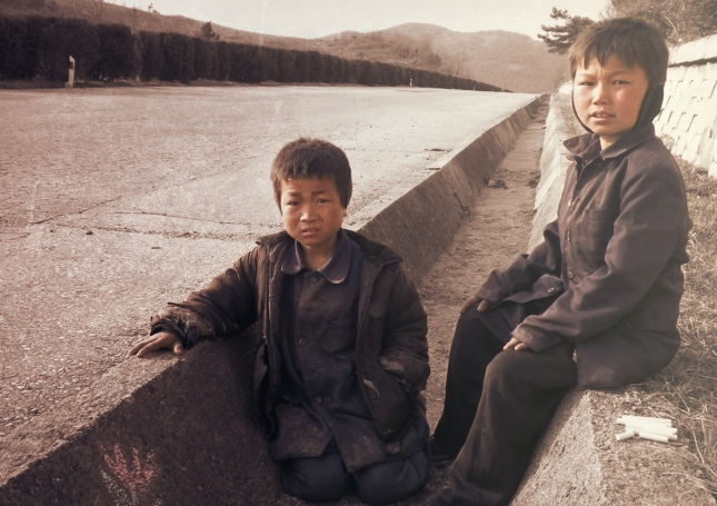 North Korean boys on the side of the highways