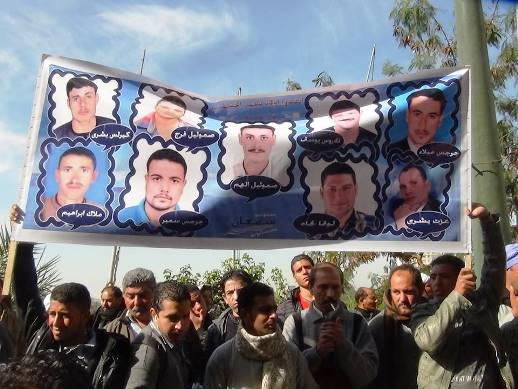 Demonstrators in Egypt hold up banner showing the faces of nine of the murdered Copts
