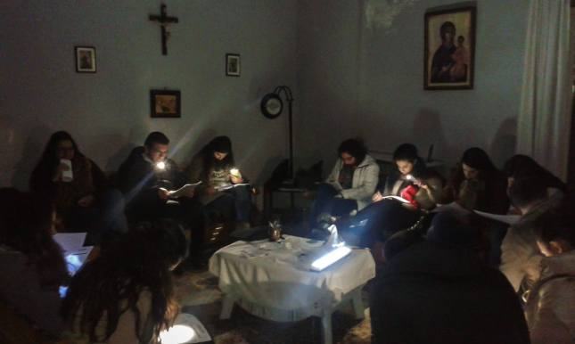 Believers meeting to study God's word, despite the lack of electricity.