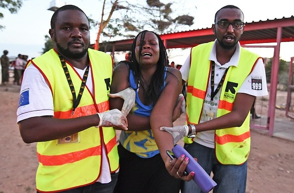 Paramedics help a student who was injured during an attack by Somalia's Al-Qaeda-linked Shebab gunmen on the Moi University campus in Garissa on April 2, 2015. (Photo credit: CARL DE SOUZA/AFP/Getty Images)
