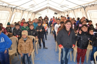 Iraq - Displaced believers meeting in a tent for church.