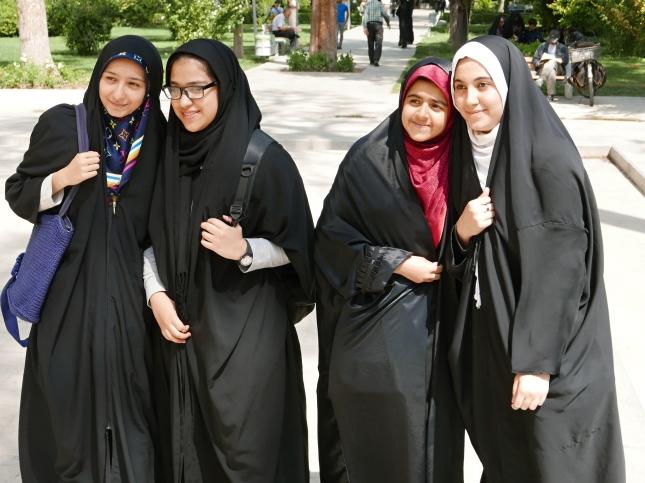 Teenage girls in Iran, wearing traditional clothing.
