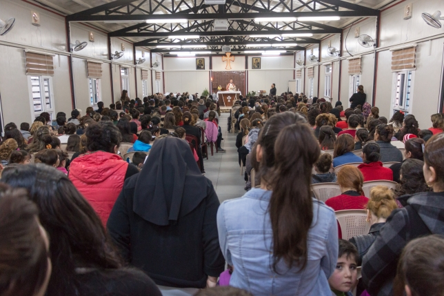 Displaced Christians in a church service in Eribil, Iraq.