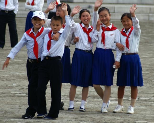 Children waving at the camera.