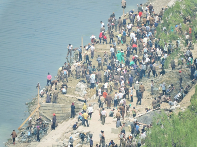 People gathering at the side of the river.
