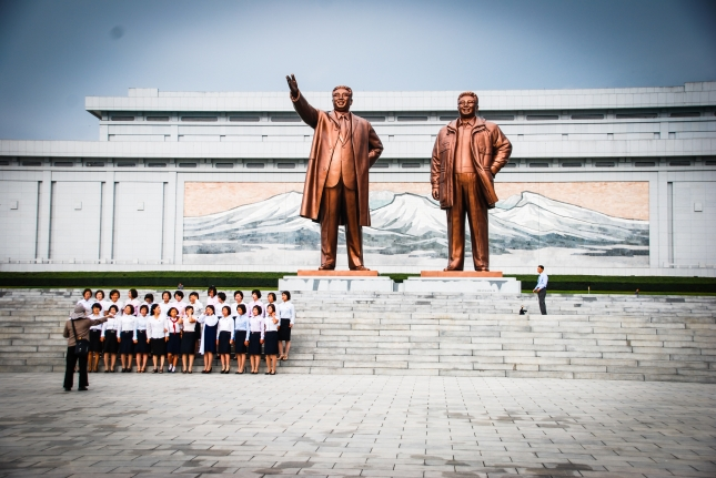 Students gather at the Mansu Hill Grand Monument for deceased leaders Kim Il-sung and Kim Jong-il.