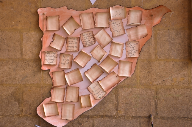 Syrian Christians have been continually praying for their nation, suffering from civil war. This map, filled with prayer notes, is from a prayer gathering in 2013.