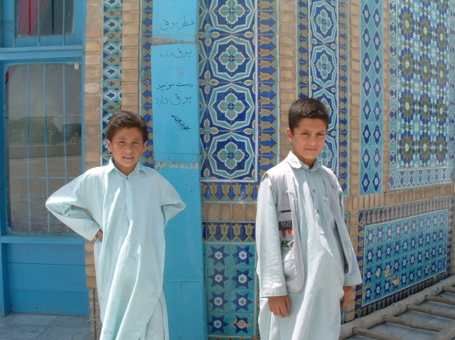Two Afghan teenagers near the Blue Mosque in the city of Mazar-i-Sharif. Date: 2002