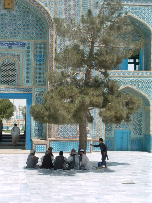 Men sitting in front of the Blue Mosque in the city of Mazar-i-Sharif. Date: 2002