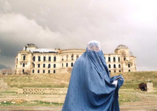 Woman in front of the Darul Aman Palace, Kabul. Date: 2003