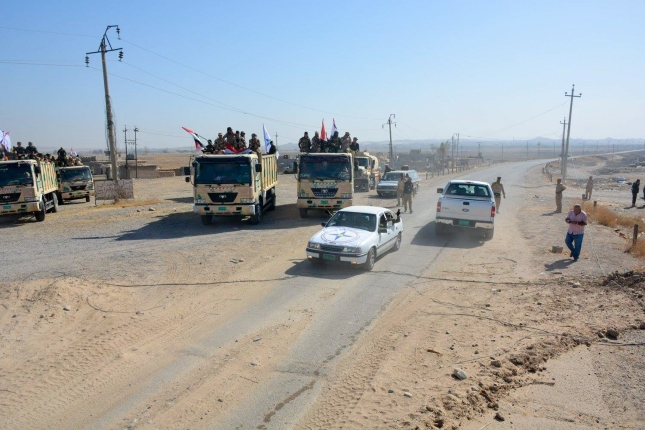 Army vehicles head for Qaraqosh.