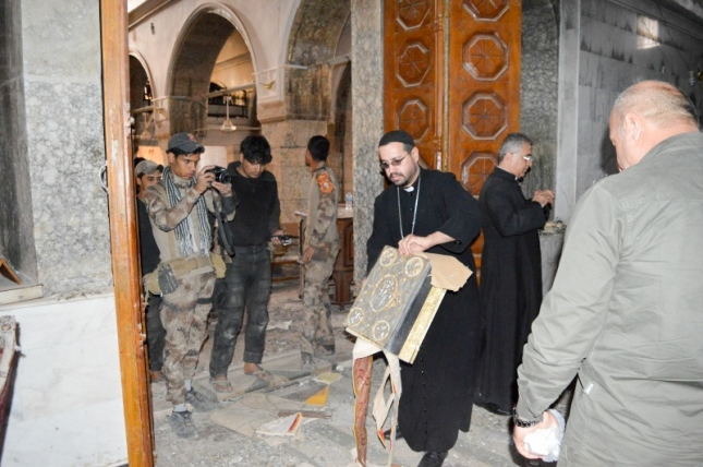 Father Yacoub finds an ancient manuscript/Bible in the ruins of his church.