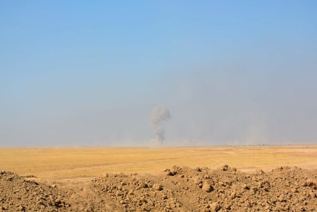 An explosion in the distance, around Mosul. Captured as soldiers headed towards Qaraqosh.