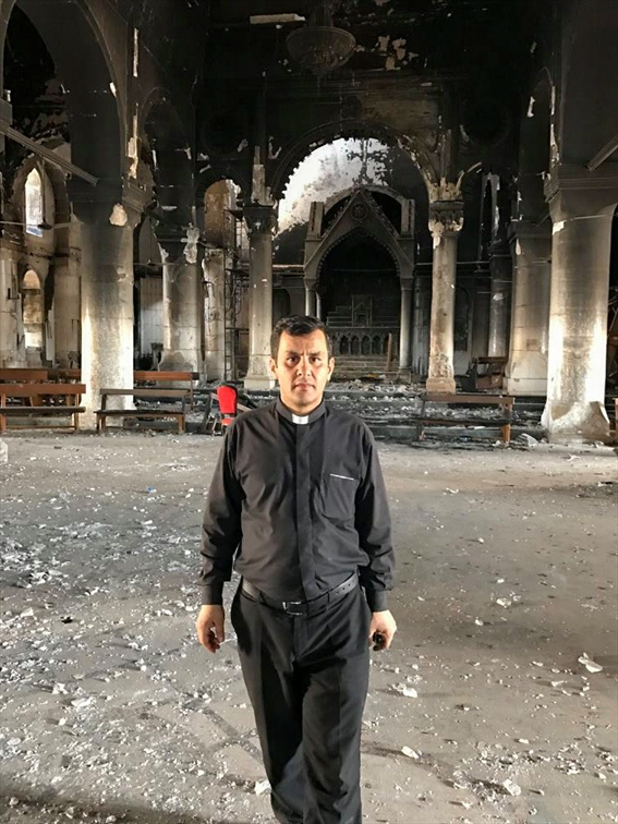 Father Ammar in Tahir church, Qaraqosh. He went to the town shortly after it was liberated.