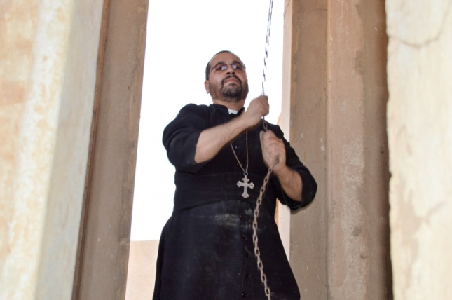 Father Yacoub rings the bells of his church for the first time in 2 years and 3 months!