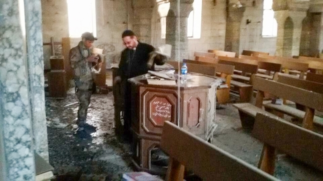 Father Yacoub sees the destruction of his church for the first time.
