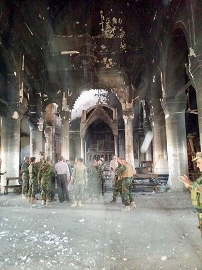 Tahira church, also known as New Church of Immaculate, was heavily damaged and burnt out.