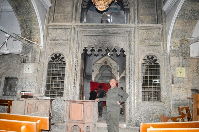 Mart Shmony church in Bartella. Much of the inside is burnt, but manuscripts, books and Bibles have been taken back to the safe city of Erbil.