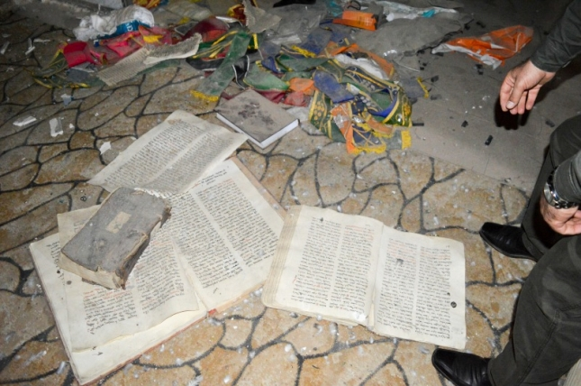 Rubble and Syriac manuscripts on the floor of a church in Bartella.