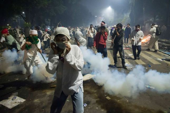 Police let off tear gas during the protest. Reuters: Antara Foto/Widodo S Jusuf