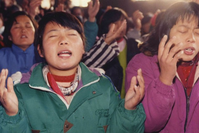 Chinese believers worshipping.