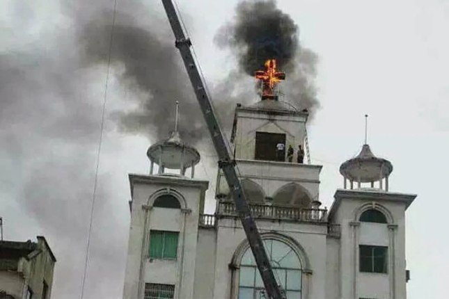 Over 1,500 crosses have been removed from churches in China over the last year. Some have been burnt or demolished. (Image:ABC news, Wayne Mcallister)